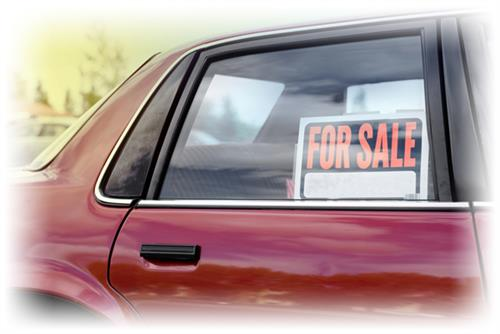 Car with for sale sign in window