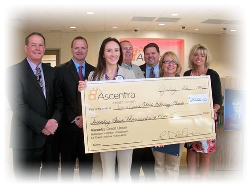 Ascentra staff present check to Rotary