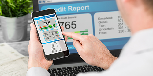 Man checking his credit report on phone