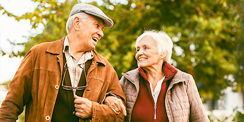 Retired couple on a walk.