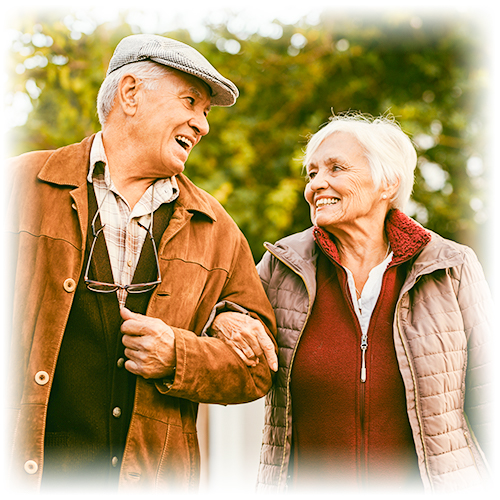 Retired couple walking through the park.