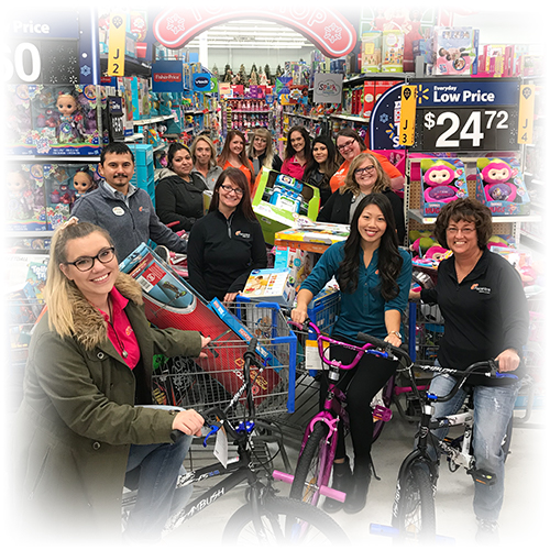 Ascentra staff shopping for Toys for Tots