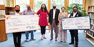 Credit union members at a check presentation