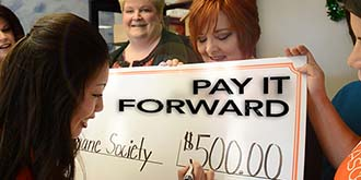 Ascentra pays it forward with five hundred dollar check.