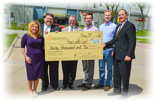 Ascentra presents thirty thousand dollars to Run with Carl