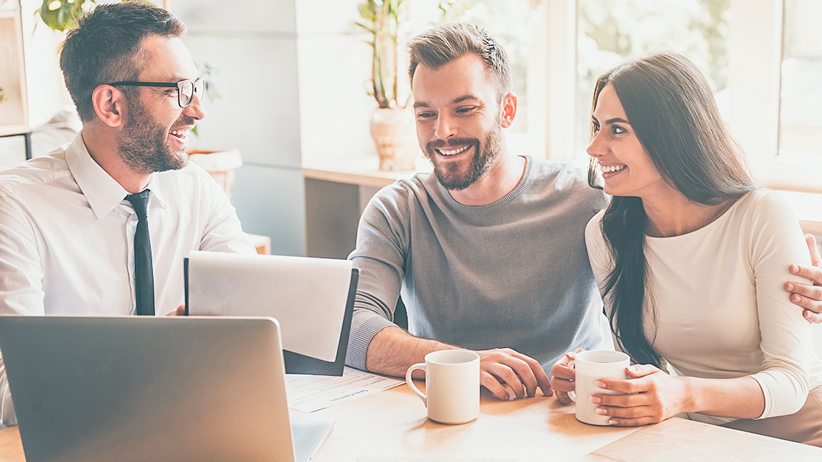 Couple drinking coffee with Mortgage Expert