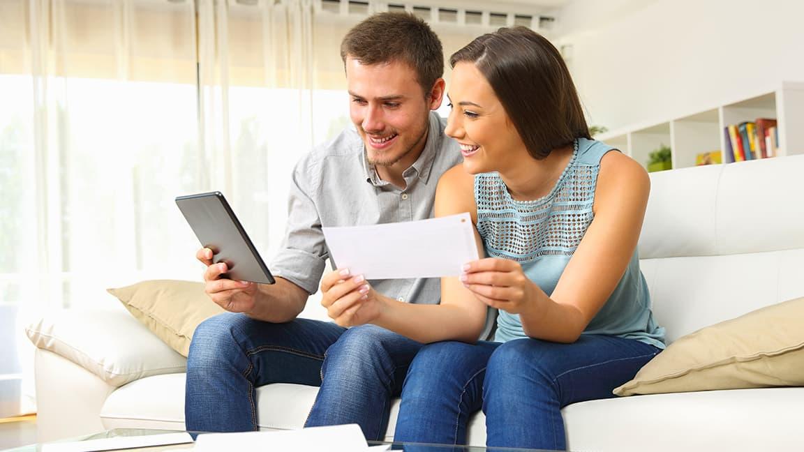 Couple paying bills via phone