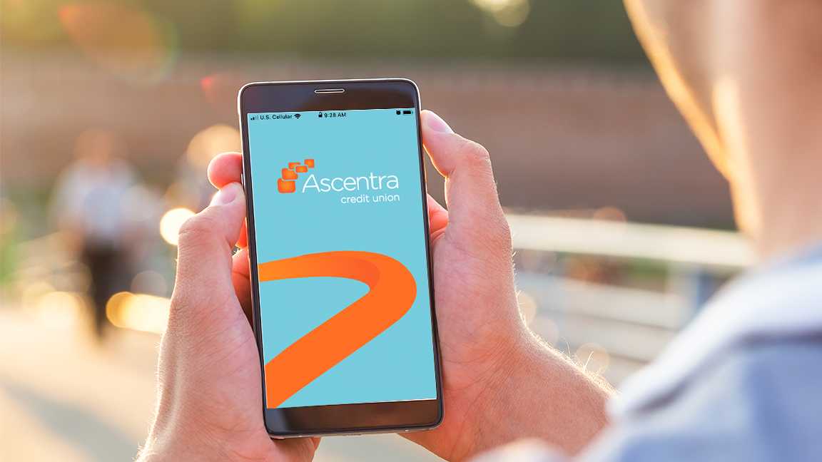 Someone using the Ascentra Credit Union mobile app