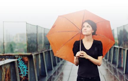 Girl with orange umbrella