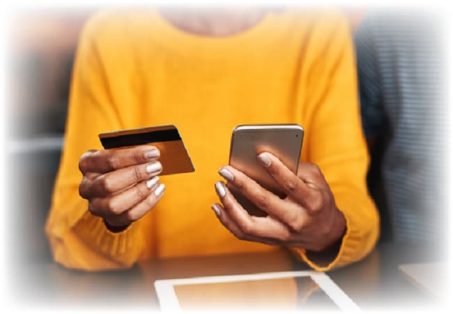 Person holding phone and debit card